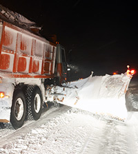 Snow plow during storm