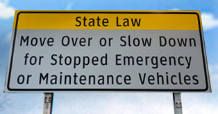 Move Over or Slow Down sign